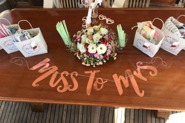 Miss to Mrs table decoration, party bags and flowers