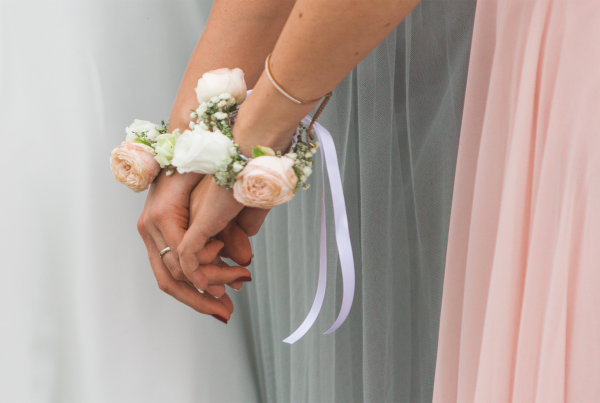 Bride and maid of honour holding hands