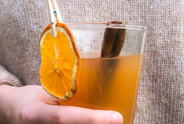 Hot cocktail with cinnamon and orange.