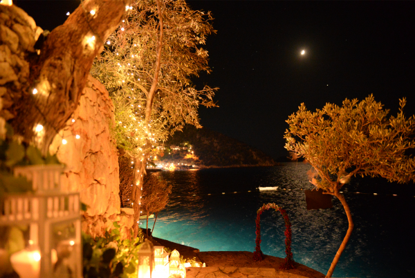 Flower arch by the sea at night